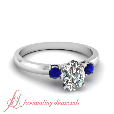 .65 Ct Platinum Engagement Rings With Oval Shaped Diamond And Blue Sapphire GIA