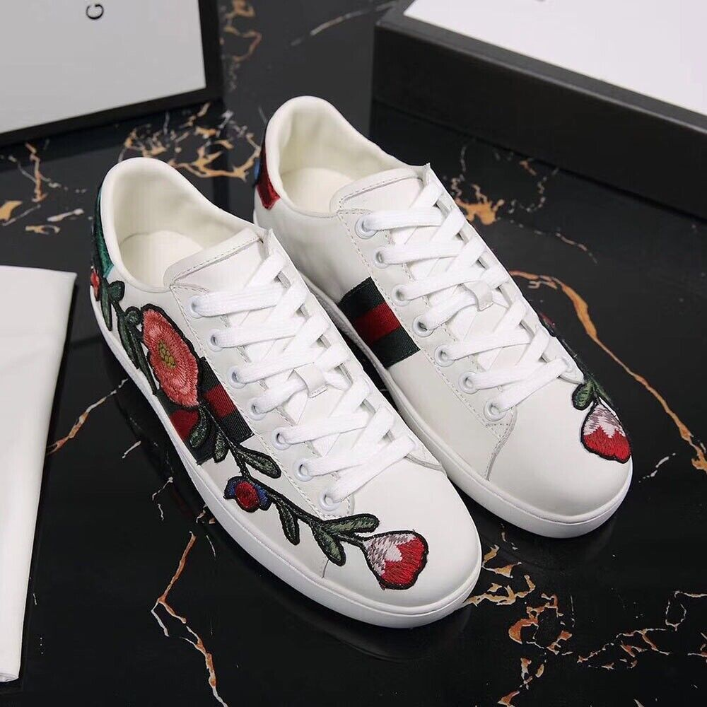 0b9f48d8b49 Gucci Ace floral embroidered leather trainers