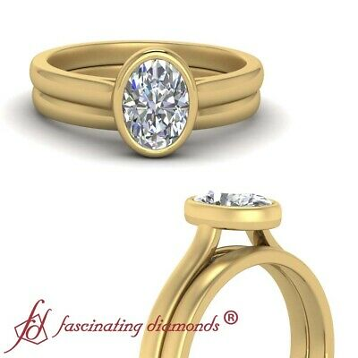 Bezel Set Solitaire Engagement Ring And Band With Oval Shaped Diamond 0.75 Carat