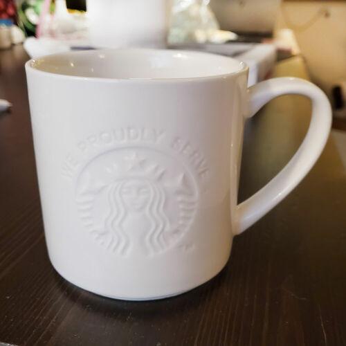 STARBUCKS We Proudly Serve White Embossed Logo Coffee Mug Cup 12 oz