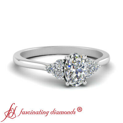 3/4 Carat Oval Shaped Diamond Cathedral Engagement Ring For Women In White Gold