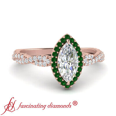 Halo Engagement Ring With 0.75 Carat Marquise Cut Diamond And Emerald Gemstone