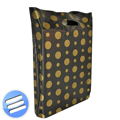 25 x BLACK GOLD POLKA DOT PLASTIC PUNCH HANDLE CARRIER BAGS: MEDIUM 15