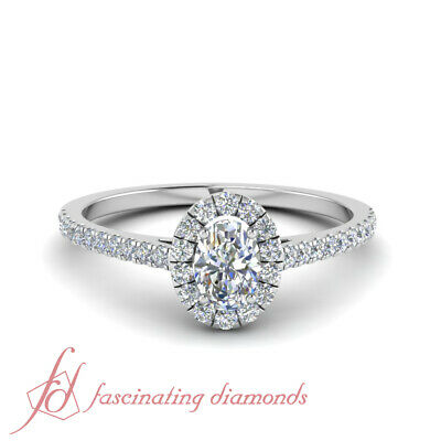 Oval Shaped Diamond Cathedral Style Halo Engagement Ring In White Gold 0.86 Ctw