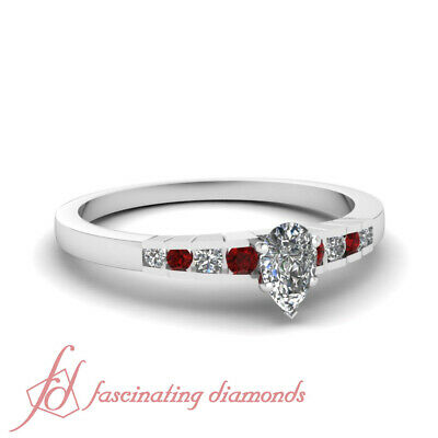 1/2 Carat Platinum Engagement Ring With Pear Shaped Diamond And Round Ruby GIA