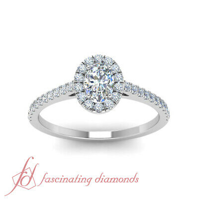 Oval Shaped Diamond Cathedral Style Halo Engagement Ring In White Gold 0.86 Ctw 1