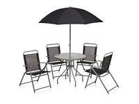 Garden table, 4 chairs and parasol - good condition