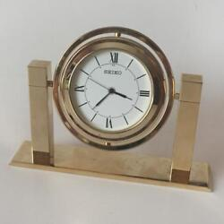 SEIKO gold tone table clock rotating QHG355G. Case measured 2 3/4 in ... Lot 35
