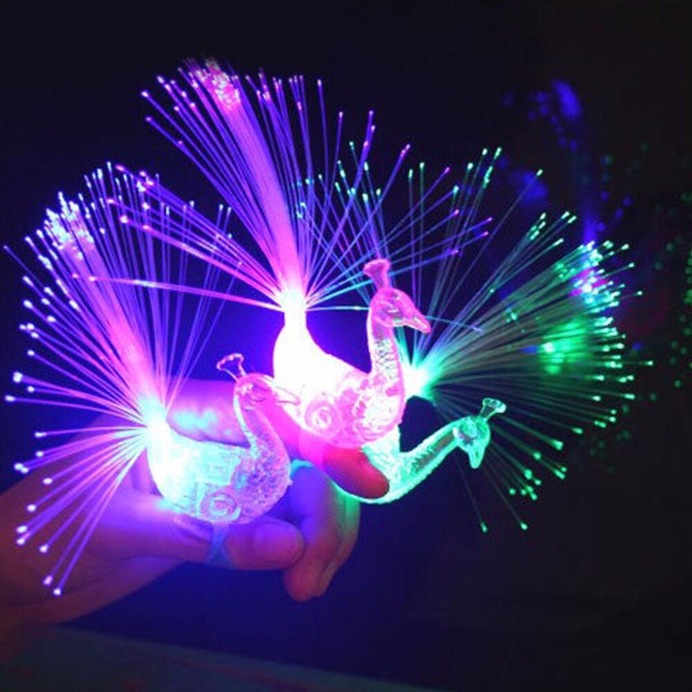 Beautiful Peacock Light Up Finger Ring Laser LED Glow In Dark Stick Kids Toys