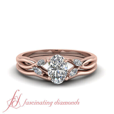 .65 Carat Oval Shaped GIA Certified Diamond Engagement Ring With Matching Band