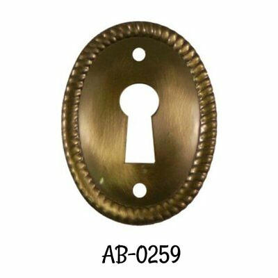 Antiqued Keyhole Stamped Brass Oval Vertical Keyhole Cover with Rope Edging ()