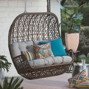 brown front porch swing hanging brown wicker egg chair indoor outdoor loveseat
