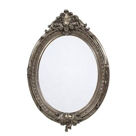 French ornate large silver oval mirror