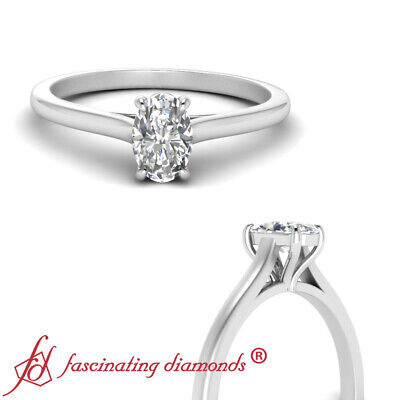 Half Carat Oval Shape Diamond Cathedral Solitaire Wedding Ring In 18K White Gold