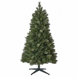 4' artificial Christmas tree in good condition.