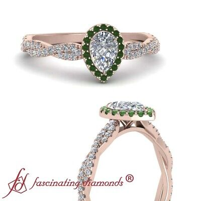 .75 Carat Pear Shape Diamond And Round Emerald Gemstones Twisted Engagement Ring