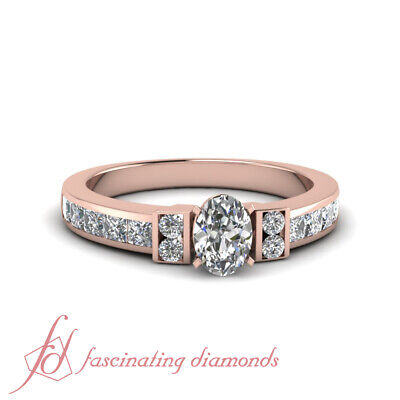 1.50 Ct Channel Set Wedding Ring With Oval Shaped Diamond In 14K Rose Gold GIA