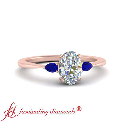 Tapered Style Oval Shaped Diamond And Sapphire Gemstone Engagement Ring 0.90 Ctw
