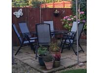 Price reduced 6 seater garden table and chair set