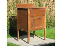 Antique washstand in need of tlc. Wash stand has pear drop handles and castors.