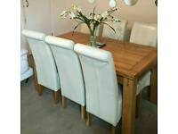 6ft solid oak extendable table with 6 cream leather chairs only £450