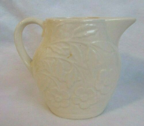 VINTAGE POTTERY OFF WHITE COLOR OVAL 1 QUART PITCHER WITH FLOWERS AND LEAVES