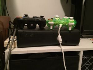 Black Xbox 360 with 2 remotes and 11 games Mannering Park Wyong Area Preview