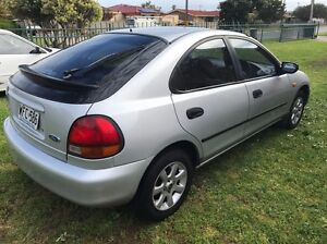 Ford Laser 1998 Lxi 4 door Hatch 4cyl 5 speed manual cold Ac !!!! Seaford Morphett Vale Area Preview
