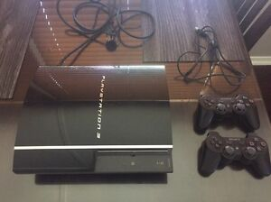PS3 console and two remotes Woombye Maroochydore Area Preview