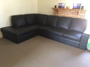 Black leather chaise Lounge Appin Wollondilly Area Preview