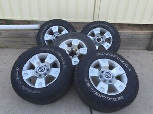 Nissan patrol rims with leather wheel cover Wetherill Park Fairfield Area Preview