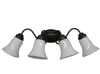 - Tannery Bronze And Cased Opal Glass 4 Light Bath Wall Fixture