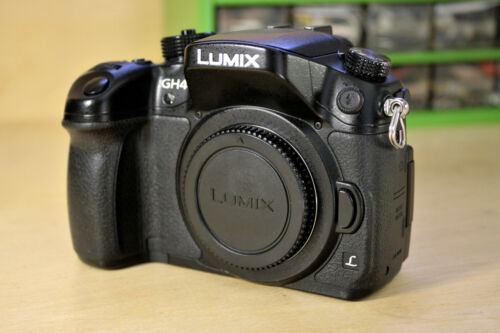 Panasonic Lumix DMC-GH4 Camera with 2 batteries, charger and Battery Grip.