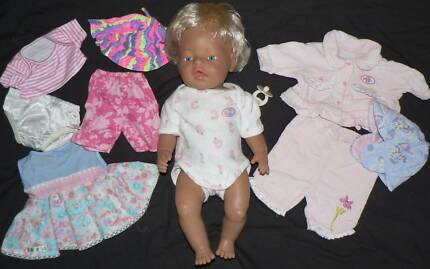 Zapf Baby Born doll with blonde hair plus outfits.