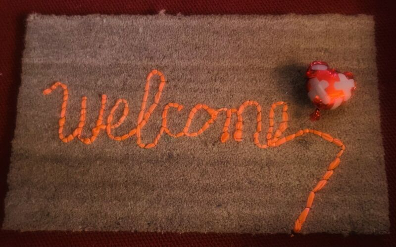 Banksy Gross Domestic Product Inspired Welcome Mat With Bonus Heart Balloon