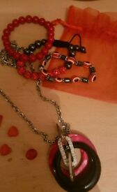 Red and black jewellery set.