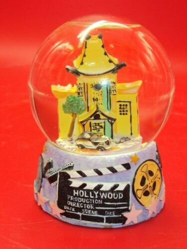 """HOLLYWOOD SNOW GLOBE - GRAUMANS CHINESE THEATRE - 4 1/2"""" TALL - NICE"""
