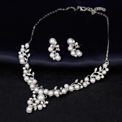Vintage signed Trifari faux pearl and rhinestone leaf necklace and earrings