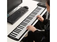 Brand new - 61 Keys Silicone Flexible Roll Up MIDI Electronic Piano Keyboard. Rechargeable