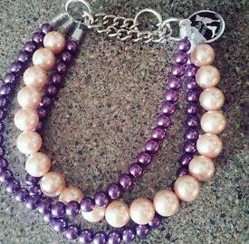 Unbreakable pearl dog collar