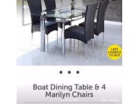 Black glass and chrome dining table