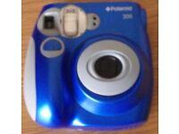 Polaroid 300 Camera Blue . Needs batteries and film
