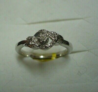 Diamond Ring Size  7  7 diamonds .07tcw MSRP$399