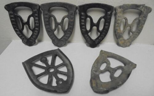 Antique Cast Iron WH Howell Sad Iron Trivet Lot Of 6