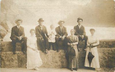RPPC~Men Sit on Wall~Gals Hold Umbrella, Purses; Boy Handles Big Knife? 1907-18