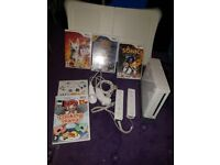 Nintendo Wii with 5 games and wii board