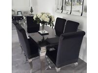 Black gloss dining table and 6 chairs.