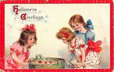 Bobbing For Apples Halloween (1911 Three Girls Bobbing for Apples Halloween post card as is sgd.)