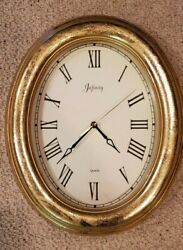 Infinity Quartz Oval Gold Leaf clock with Roman Numerals
