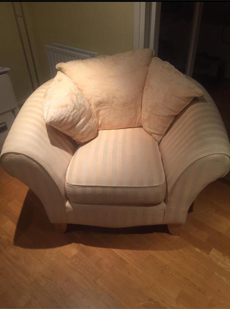 Beige tub chair